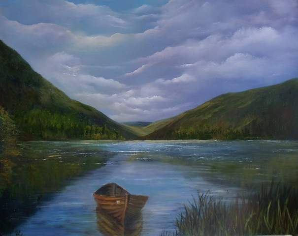 Moored boat , Irish mountain range, scenic Ireland, reflections