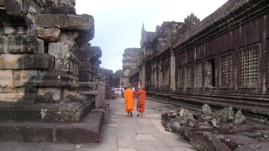 Buddhist monks stroll through the temple