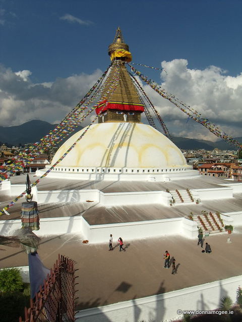 Boudhnath Stupa, Nepal - Pilgrims circulate clockwise, spinning prayer wheels